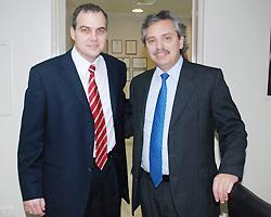 Gustavo Eduardo Ick junto a Alberto Fernández
